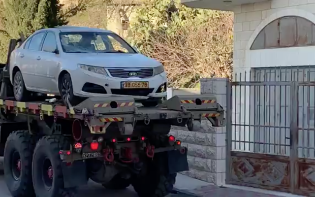 Israeli security forces seize a car in the West Bank town of Beit Jala that was used in a car-ramming attack against a group of IDF soldiers in Jerusalem earlier in the day on February 6, 2020. (Screen capture)