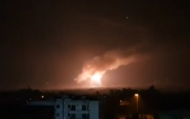A fireball lights up the night sky near Damascus during an attack on a target near the capital on February 23, 2020. (Screen capture: Al-Ikhbariyah Syria TV)