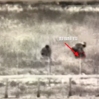 Israeli military surveillance footage of two alleged Palestinian Islamic Jihad members planting what appears to be a bomb along the Gaza border on February 23, 2020. (Screen capture: Israel Defense Forces)