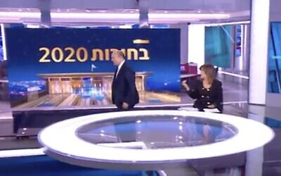 Defense Minister Naftali Bennett (L) walks out of an interview with Channel 12's Rina Matzliah on February 28, 2020. (Screen capture: Channel 12)