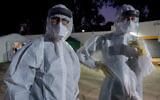 Medical staff at Tel Hashomer Hospital await Israelis under coronavirus quarantine, February 20, 2020. (Avshalom Sassoni/Flash90)