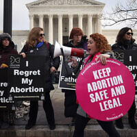 Protesters on both sides of the abortion issue gather in front of the U.S. Supreme Court building during the Right To Life March, on January 18, 2019 in Washington, DC. (Mark Wilson/Getty Images via JTA)