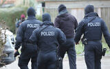 Illustrative: Police during a raid in northern Germany, Jan. 30, 2019. (Bodo Marks/dpa via AP)
