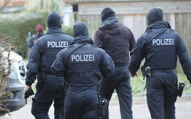Illustrative: Police during a raid in northern Germany, Jan. 30, 2019. (Bodo Marks/dpa via AP)