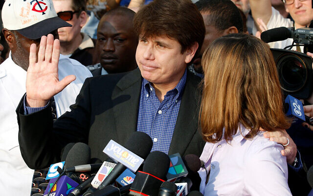 Former Illinois Gov. Rod Blagojevich, with his wife Patti at his side, speaks to the media in Chicago before reporting to federal prison in Denver, March 14, 2012. (AP Photo/M. Spencer Green, File)