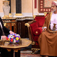 Oman's Sultan Haitham bin Tariq, right, meets with US Secretary of State Mike Pompeo, left, at al-Alam palace in the capital Muscat Feb. 21, 2020. (Andrew Caballero-Reynolds/Pool via AP)