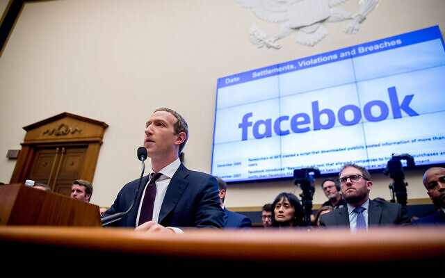 Facebook CEO Mark Zuckerberg testifies before a House Financial Services Committee hearing on Capitol Hill in Washington, Oct. 23, 2019. (AP Photo/Andrew Harnik)