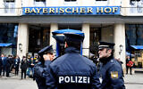German police officers stand in front of the Bayerischer Hot hotel on the first day of the Munich Security Conference in Munich, Germany, Feb. 14, 2020. (AP/Jens Meyer)b