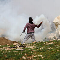 Palestinian demonstrators clash with Israeli forces during a protest in the village of Kfar Qaddum, near the West Bank city of Nablus February 14, 2020. (Nasser Ishtayeh/Flash90)
