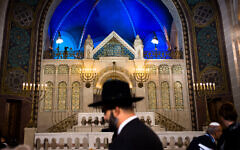 A rabbi arrives at a synagogue in Berlin to attend an event commemorating Kristallnacht, Nov. 9, 2018. (AP Photo/Markus Schreiber, file)