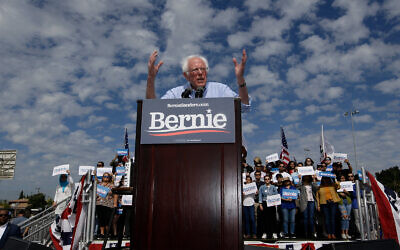 Democratic presidential hopeful Senator Bernie Sanders speaks at a campaign event at Valley High School in Santa Ana, Calif., Feb. 21, 2020. (AP Photo/Damian Dovarganes)