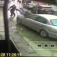 A rabbi accidentally plows a Jaguar into two pedestrians on a London sidewalk, March 2018. (Screenshot)