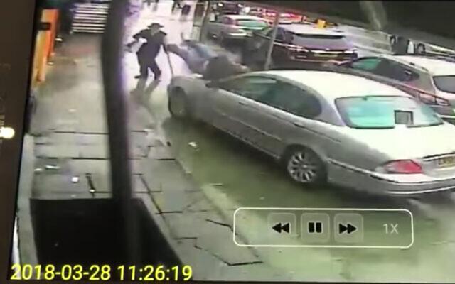 A rabbi accidentally plows a Jaguar into two pedestrians on a London sidewalk, March 2018. (Screenshot)