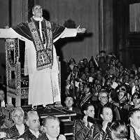 Pope Pius XII blesses faithful at the Vatican, March 4, 1949. (INTERCONTINENTALE / AFP)