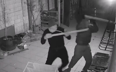 Masked vandals attack the home of a witness who testified against Rabbi Eliezer Berland, a convicted sex offender accused of fraud. (YouTube screenshot)