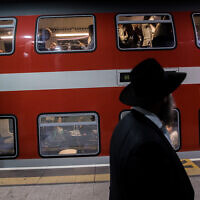 Illustrative: Passengers at Yitzhak Navon train station in Jerusalem, December 18, 2019. (Yonatan Sindel/Flash90)