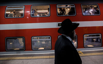 Illustrative: Passengers at Yitzhak Navon train station in Jerusalem, December 18, 2019. (Yonatan Sindel/Flash90)