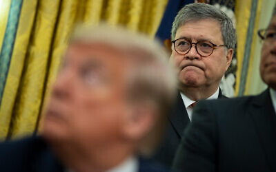 US Attorney General William Barr listens as President Donald Trump speaks at the White House, Nov. 26, 2019, in Washington. (AP Photo/ Evan Vucci)