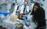Researchers work in a lab that is developing testing for the COVID-19 coronavirus at Hackensack Meridian Health Center for Discovery and Innovation on February 28, 2020 in Nutley, New Jersey. (Keta Betancur/Getty Images North America/AFP)