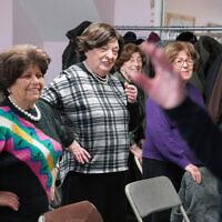 Holocaust survivors Edith Jacobs, Shirley Fernbach, Jean Kurtz, Adele Rubinstein, and Eva Friedman attend an exercise class led by Mindy Landau at Nachas Health and Family Network in Brooklyn, New York, January  22, 2020. (AP Photo/Emily Leshner)