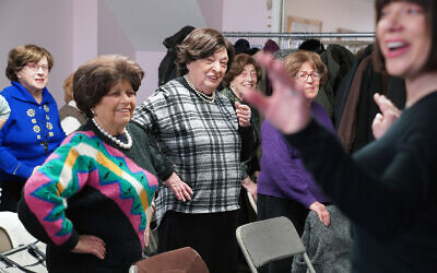 Holocaust survivors Edith Jacobs, Shirley Fernbach, Jean Kurtz, Adele Rubinstein, and Eva Friedman attend an exercise class led by Mindy Landau at Nachas Health and Family Network in Brooklyn, New York, January  22, 2020. (AP Photo/Emily Leshner)