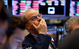 Trader David O'Day works on the floor of the New York Stock Exchange as equities plummet due to the coronavirus outbreak, Feb. 28, 2020. (AP/Richard Drew)