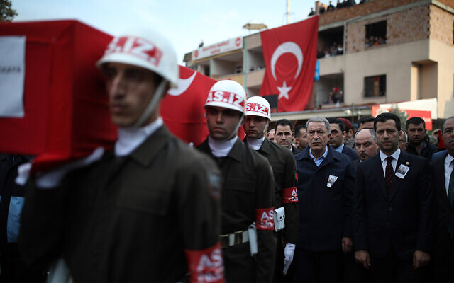 Turkey's Defense Minister Hulusi Akar, third right, attends a funeral ceremony for Halil Ibrahim Akkaya, one of dozens of Turkish soldiers killed in Syria, in Bahce, Osmaniye, Turkey, Feb. 28, 2020. (AP)