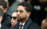 Former 'Empire' actor Jussie Smollett, center, arrives for a court appearance at the Leighton Criminal Courthouse in Chicago, February 24, 2020. (AP Photo/Charles Rex Arbogast)