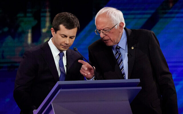 Democratic presidential candidates Pete Buttigieg, left and Bernie Sanders, right, talk during a break during a primary debate in Houston, Texas, Sept. 12, 2019. (AP/David J. Phillip)