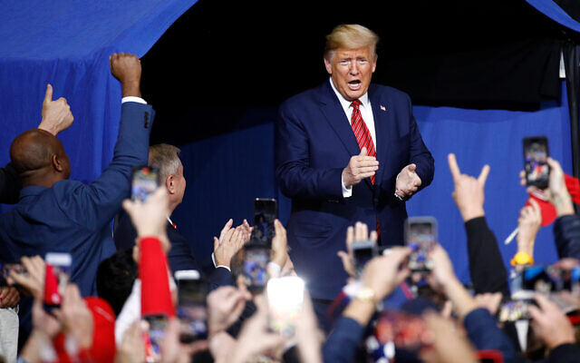 US President Donald Trump walks onstage at a campaign rally, in North Charleston, South Carolina, Feb. 28, 2020. (AP/Patrick Semansky)