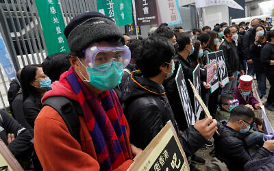 Medical staff strike over coronavirus concerns outside government headquarters in Hong Kong, February 5, 2020. (AP Photo/Vincent Yu)
