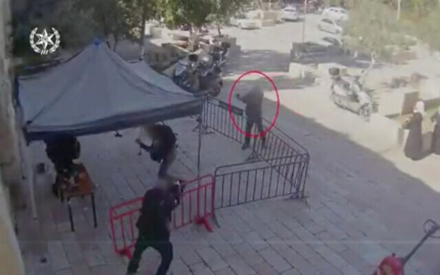 An Arab Israeli man opens fire on police officers in Jerusalem in footage published by police, February 6, 2020. (Screenshot/Israel police)
