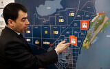Lebanon's Energy Minister Cesar Abi Khalil, explains an offshore drilling map on disputed waters with Israe, Feb. 1, 2018. (AP Photo/Hussein Malla)