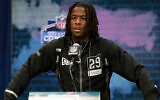 Alabama wide receiver Jerry Jeudy speaks during a press conference at the NFL football scouting combine in Indianapolis, Feb. 25, 2020. (AP Photo/Michael Conroy)