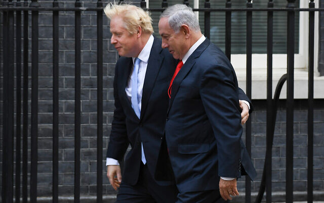Britain's Prime Minister Boris Johnson greets Prime Minister Benjamin Netanyahu at Downing Street, in London, Sept. 5, 2019.(AP Photo/Alberto Pezzali)