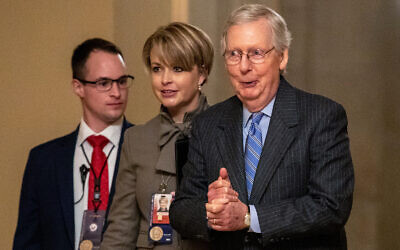 Senate Majority Leader Mitch McConnell, right, walks to meet with Senate Republicans on Capitol Hill in Washington after the Senate voted to not allow witnesses in the impeachment trial of US President Donald Trump, January 31, 2020. (AP Photo/Jacquelyn Martin)