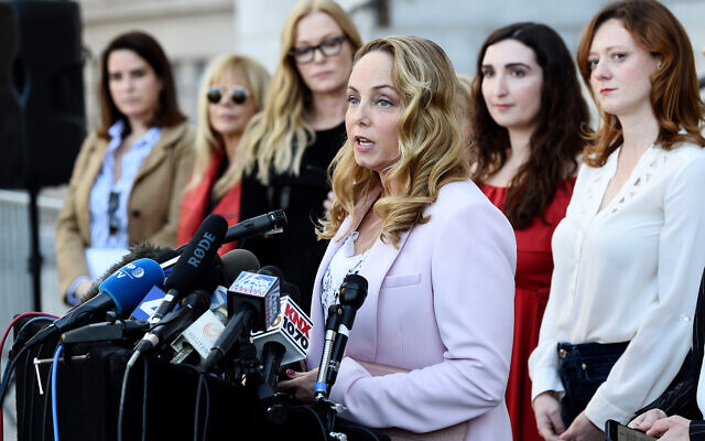 "Actress Louisette Geiss addresses the media at a news conference by the ""Silence Breakers,"" a group of women who have spoken out about Hollywood producer Harvey Weinstein's sexual misconduct, at Los Angeles City Hall, Feb. 25, 2020. (AP Photo/Chris Pizzello)"