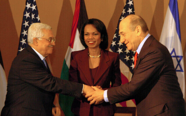 United States Secretary of State Condoleezza Rice, center, gestures to Israeli Prime Minister Ehud Olmert, right, and Palestinian Authority President Mahmoud Abbas, left, at a meeting at a hotel in Jerusalem, on February 19, 2007. (Flash90)