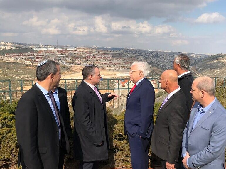 US Ambassador to Israel David Friedman (4th from right) tours the Efrat settlement with settler leaders on February 20, 2020. (Courtesy)