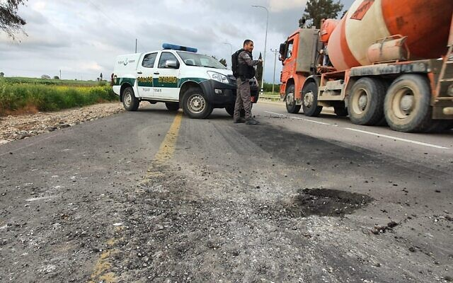 A mortar shell fired from the Gaza Strip causes damage to a road in southern Israel on February 23, 2020. (Israel Police)