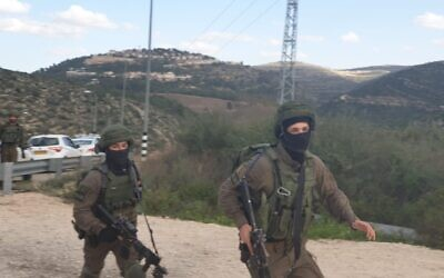Israeli troops search for a gunman who opened fire at an IDF soldier, lightly injuring him, near the central West Bank settlement of Dolev on February 6, 2020. (Israel Defense Forces)