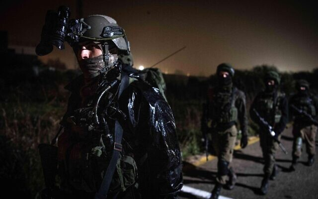 Israeli troops search for a Palestinian gunman who opened fire at IDF soldiers, injuring one of them, in the central West Bank, in February 2020. (Israel Defense Forces)