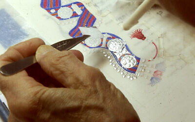 'Illuminated Book of Ruth' artist Barbara Wolff applies silver leaf to the manuscript. (Courtesy)