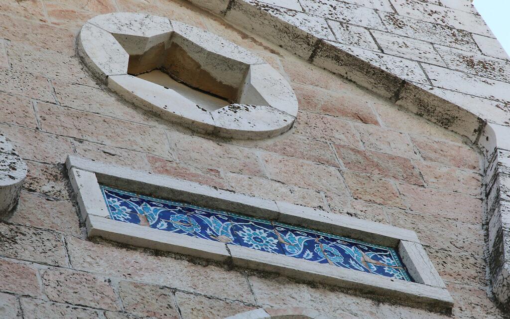 Ceramic tiles on display on a home on Shimshon street in the Jerusalem neighborhood of Bak'a. (Shmuel Bar-Am)
