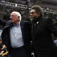Bernie Sanders and Cornel West walk onstage together during a campaign event at the Whittemore Center Arena in Durham, New Hampshire, February 10, 2020. (Joe Raedle/Getty Images via JTA)
