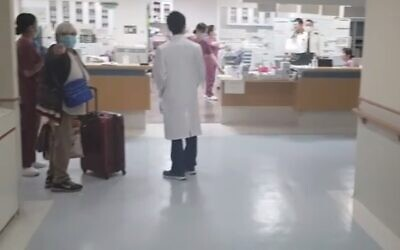 Rachel Biton is released from a Japanese medical facility after testing negative for coronavirus, February 25, 2020 (Screen grab/Channel 12 news)