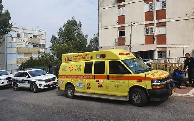 Emergency services outside a building in Afula where a mother and daughter were found dead, February 18, 2020. (Magen David Adom)