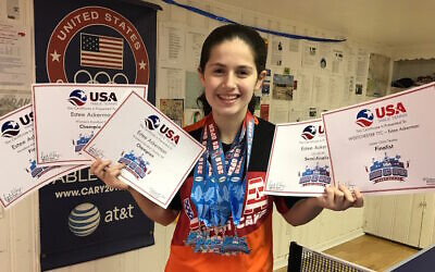 File: Estee Ackerman holding certificates representing the five medals she won in this month's US Open in table tennis (Courtesy of Estee Ackerman)