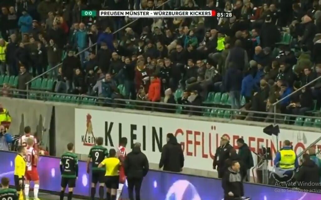 German soccer fans turn on fellow supporter for racist abuse