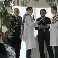 Rabbi Avram Mlotek, center, performs his first same-sex wedding, February 2020. (Courtesy of Mlotek via JTA)